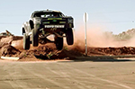 Ballistic BJ Baldwin rips through a town in his 800bhp Trophy Truck
