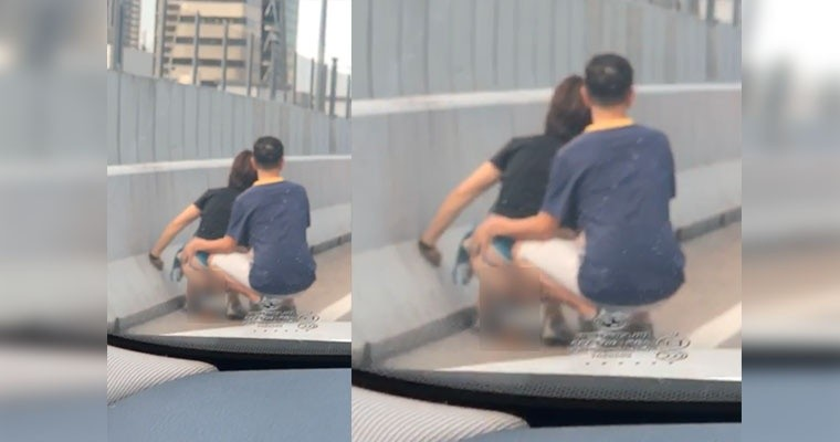 woman-caught-pooping-by-the-roadside-of-johor-singapore-highway-because-of-traffic-jam-world-of-buzz.jpg