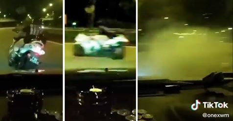Driver races with a Hayabusa and spins out of control but recovers