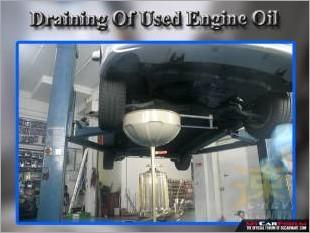 https://www.mycarforum.com/uploads/sgcarstore/data/10//Draining_Of_Used_Engine_Oil_11.jpg