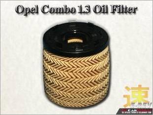 https://www.mycarforum.com/uploads/sgcarstore/data/10/Opel_Combo_13_Oil_Filter_White_Texture_Background_1.jpg