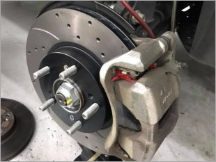 https://www.mycarforum.com/uploads/sgcarstore/data/2//slotted rotor brake pad_63788_1_96584_1_crop.jpg