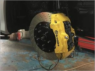 https://www.mycarforum.com/uploads/sgcarstore/data/2/Toyota_Estima_Installed_With_Our_Brembo_Brake_Kit_Yellow_Pic_3_1.jpg