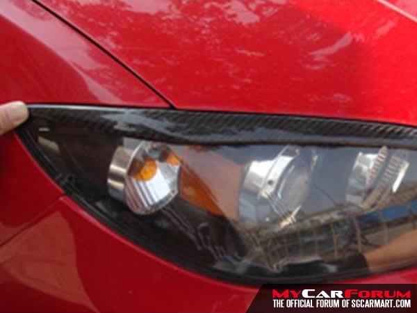 Mazda 3 Carbon Fibre Eyelid